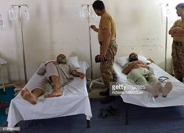 Pakistani heatstroke victims are treated at an army medical camp in Karachi on July 2 2015 More than 1200 people have died as a result of days of...