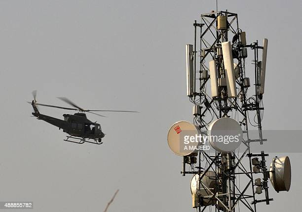 A Pakistani helicopter patrols over a Pakistan Air Force base after an attack by militants in Peshawar on September 18 2015 Militants attacked a...