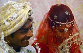 A Pakistani Hindu bride and a groom attend a mass wedding ceremony in Karachi on January 24 2016 Some 60 Hindu couples took part in a mass wedding...
