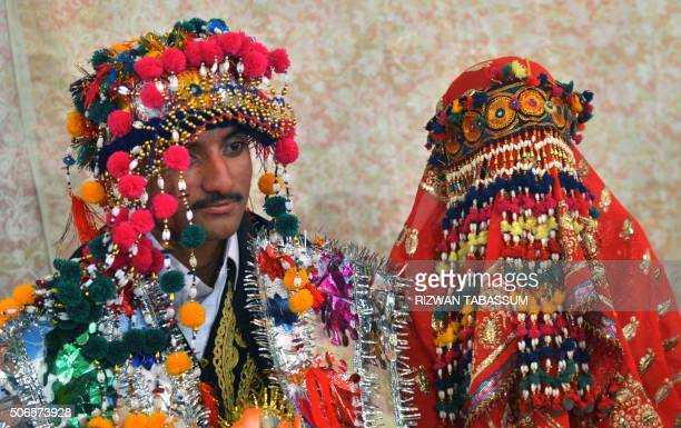 TOPSHOT Pakistani Hindu bride and groom attend a mass wedding ceremony in Karachi on January 24 2016 Some 60 Hindu couples took part in a mass...