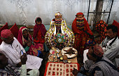 A Pakistani Hindu couple performs a Hindu ritual during a mass wedding ceremony in Karachi on January 24 2016 Some 60 Hindu couples took part in a...