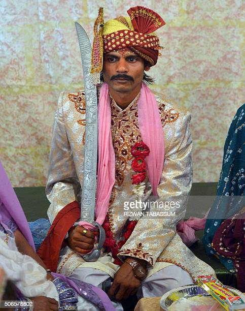 A Pakistani Hindu groom wears traditional clothes during a mass wedding ceremony in Karachi on January 24 2016 Some 60 Hindu couples took part in a...