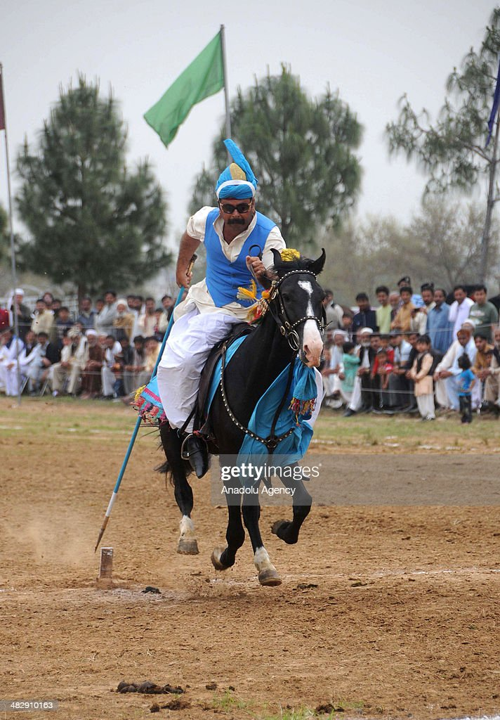 Pakistani horse rider hits his target during a tentpegging on April 5 in Islamabad Pakistan The traditional Pakistani game is known as NezaBazi and...