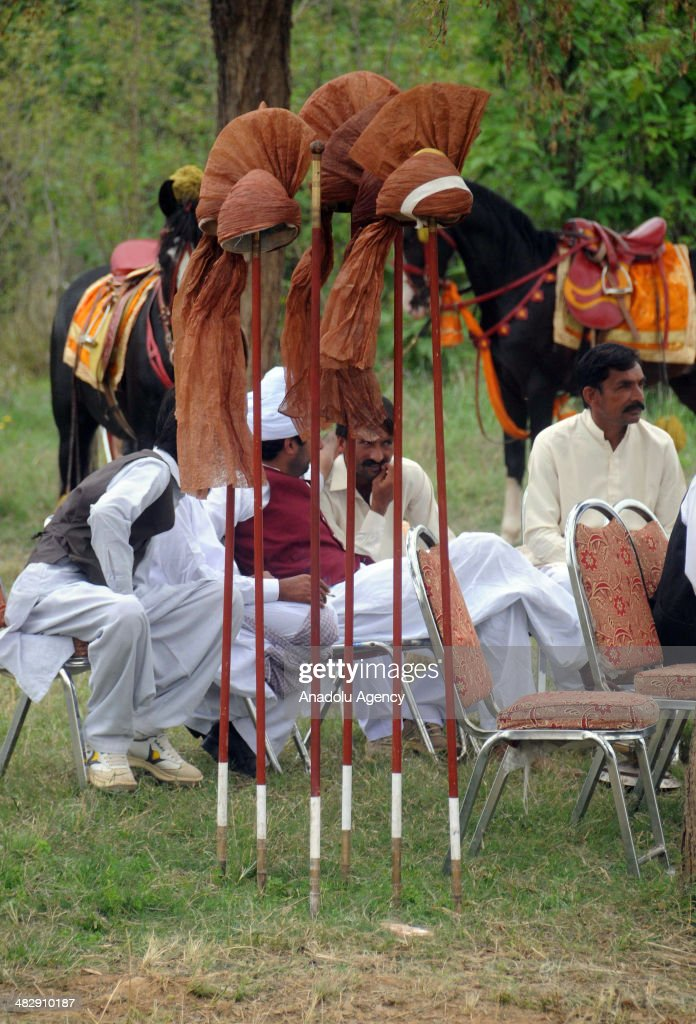 Pakistani horse riders sit prior to tentpegging on April 5 in Islamabad Pakistan The traditional Pakistani game is known as NezaBazi and the...