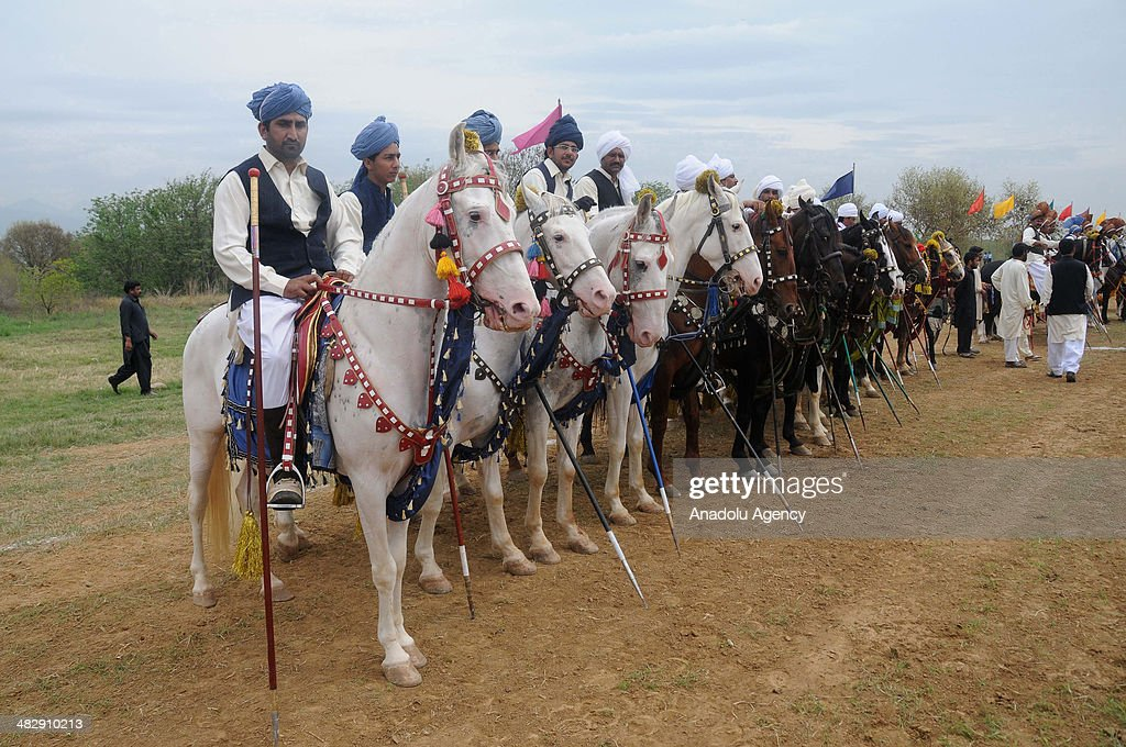 Pakistani horse riders wait to begin the competition prior to tentpegging on April 5 in Islamabad Pakistan The traditional Pakistani game is known as...