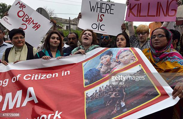 Pakistani human rights activists carry placards during a protest in support of Rohingya Muslims at a rally in Lahore on June 3 2015 Myanmar refuses...