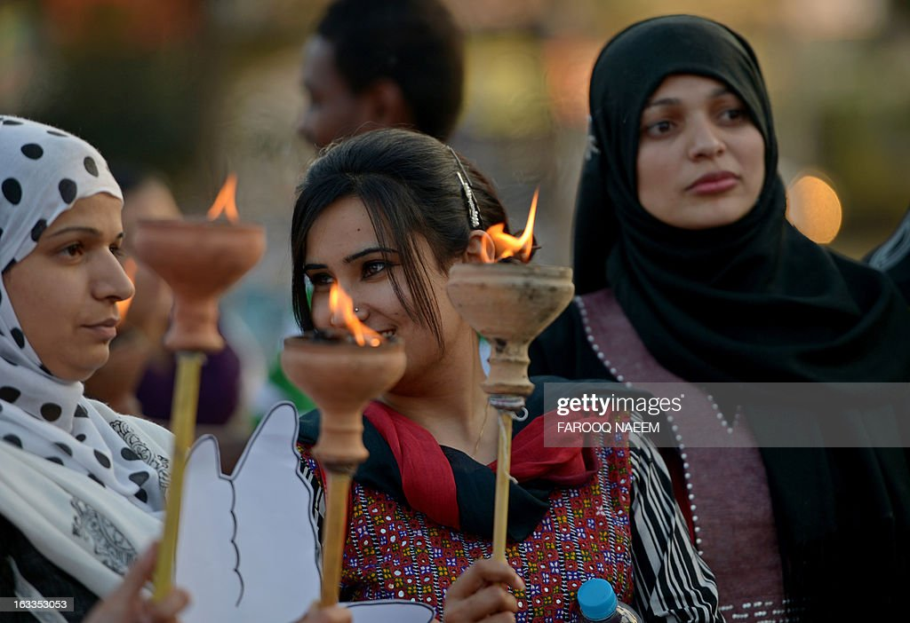 Pakistani human rights activists hold lamps during a rally to mark International Women's Day in Islamabad on March 8, 2013. The activists demonstrated to mark International Women's Day in a culture that often treats women as second-class citizens. AFP PHOTO/Farooq NAEEM
