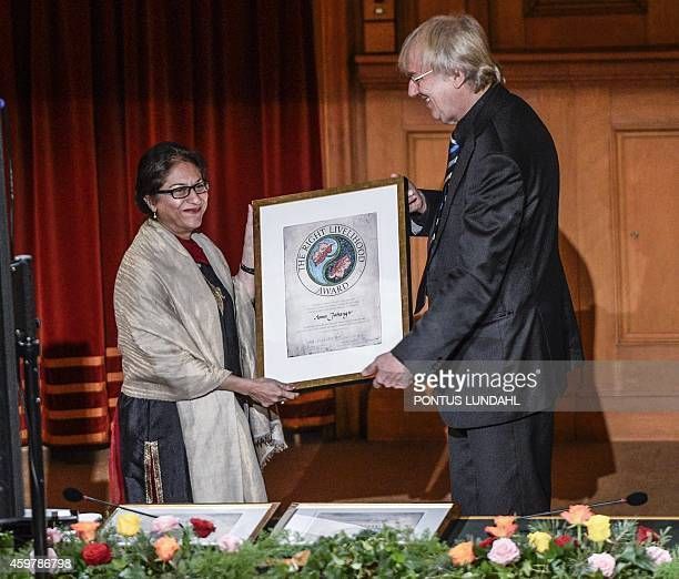 Pakistani human rights lawyer Asma Jahangir receives the Right Livelihood Award from Jakob von Uexkull during the Right Livelihood Award ceremony at...