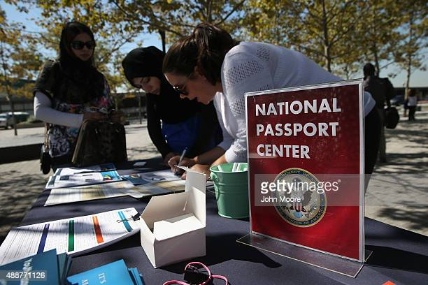 Pakistani immigrant and new American citizen applies for a US passport following a naturalization ceremony at Liberty State Park on September 17 2015...