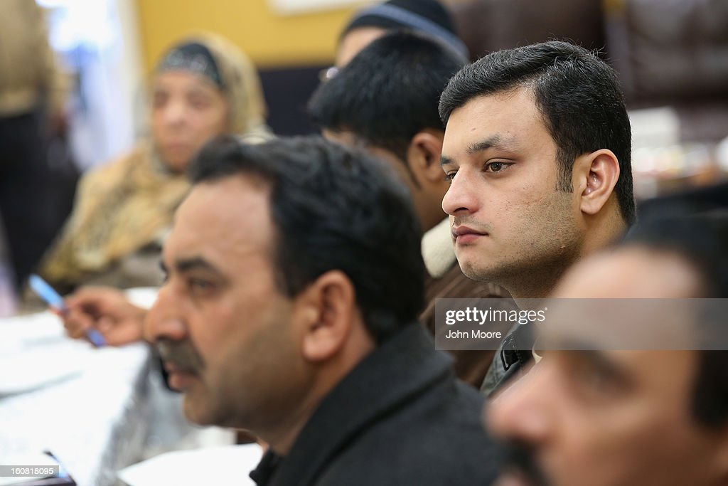 Pakistani immigrant Bilal Cheema, (R), 23, listens during an English and U.S. citizenship class on February 6, 2013 in New York City. The non-profit Council of Peoples Organization (COPO), holds the classes to help immigrants, mostly from Pakistan, learn English, assimilate to American culture and, in many cases, gain U.S. citizenship.