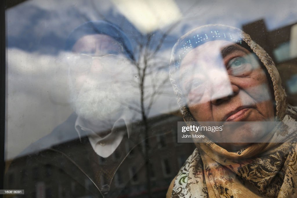 Pakistani immigrant Sabira Khatoon, 74, and her husband Wahid Ali, 78, a naturalized American from Pakistan, look from the office of the Council of Peoples Organization (COPO), after an English and U.S. citizenship class held there on February 6, 2013 in New York City. The couple was preparing for Sabira's upcoming interview for U.S. citizenship. The non-profit COPO, founded in early 2002 shortly after the 9/11 attacks, is designed to help immigrants, mostly from Pakistan, learn English, assimilate to American culture and, in many cases, gain U.S. citizenship.