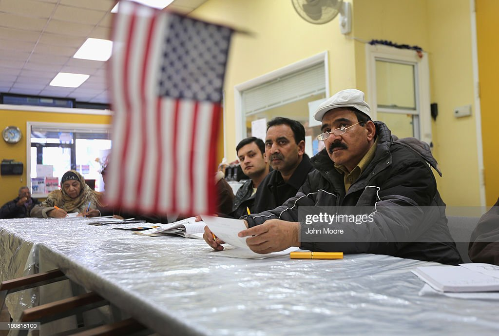 Pakistani immigrants listen during an English and U.S. citizenship class held at the office of the Council of Peoples Organization (COPO), on February 6, 2013 in New York City. The non-profit COPO, founded in early 2002 shortly after the 9/11 attacks, is designed to help immigrants, mostly from Pakistan, to learn English, assimilate to American culture and, in many cases, gain U.S. citizenship.