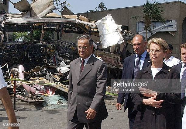 Pakistani information minister Nisar Memon and French Defence Minister Michele AlliotMarie passes by the bomb blast scene in which 11 French national...