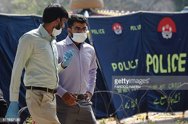 Pakistani investigators collect evidence at a suicide blast site in Lahore on March 28 2016 A suicide bomber who attacked a park thronging with...