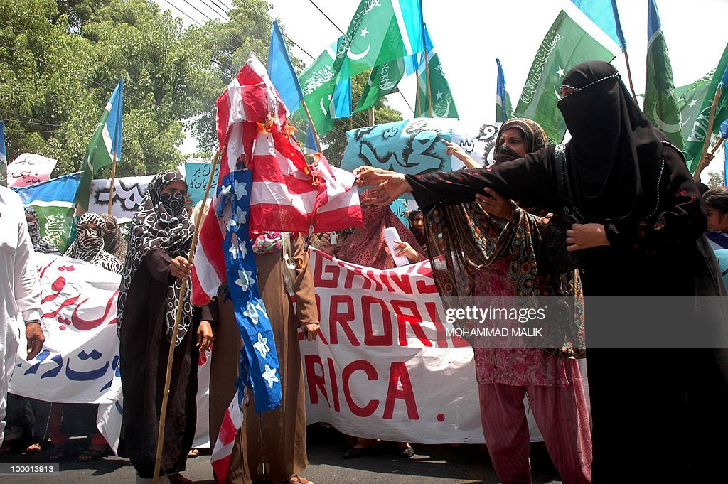 Pakistani Islamist women set a US national flag alight during a protest in Multan on May 20, 2010, against the published caricatures of Prophet Mohammed on Facebook. Pakistan condemned caricatures of the Prophet Mohammed that appeared on Facebook, blocking the social networking site and YouTube in a growing backlash over Internet 'sacrilege'. Several thousand activists protested against the drawings and denounced the West in an expression of outrage that sparked comparisons with riots across the Muslim world in 2006 over drawings published in European newspapers.