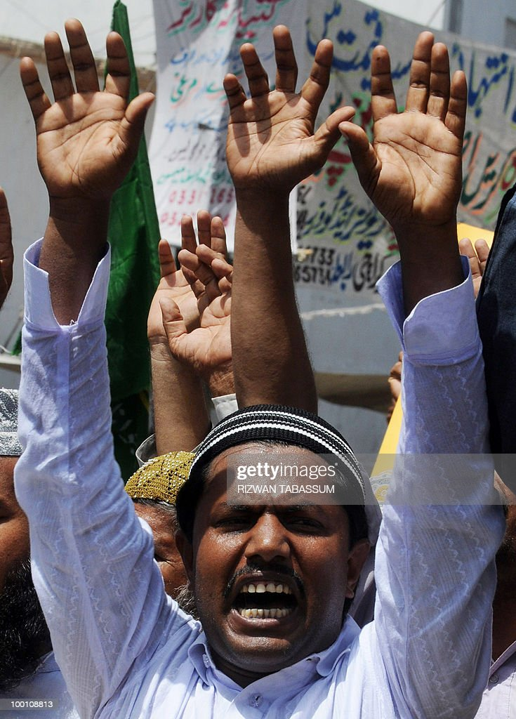 Pakistani Islamists shout slogans during a protest in Karachi on May 21, 2010, against the published caricatures of Prophet Mohammed on Facebook. Thousands of Pakistanis were expected to take to the streets to vent growing anger against Facebook and the West over 'sacrilegious' caricatures of the Prophet Mohammed on the Internet. A Facebook user organised an 'Everyone Draw Mohammed Day' competition to promote 'freedom of expression', inspired by an American woman cartoonist, but sparked a major backlash in the conservative Muslim country of 170 million.
