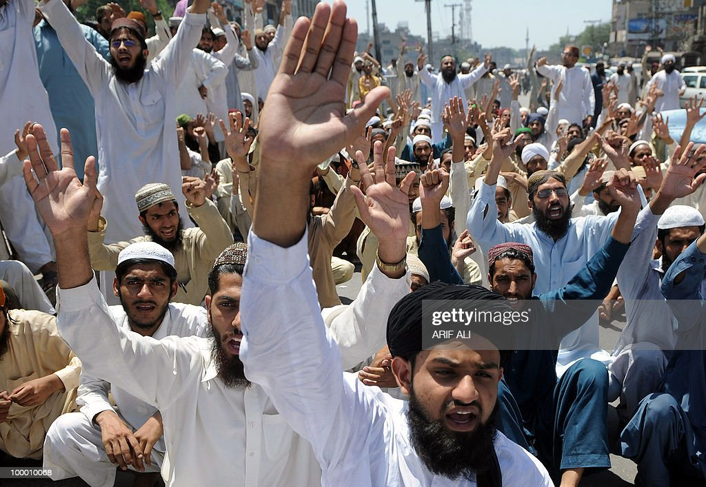 Pakistani Islamists shout slogans during a protest in Lahore on May 20, 2010, against the published caricatures of Prophet Mohammed on Facebook. Pakistan 'strongly condemned' caricatures of the Prophet Mohammed that appeared on social networking website Facebook as insulting to Muslims worldwide. The Pakistan Telecommunications Authority (PTA) blocked access to Facebook and YouTube in a growing row sparked when a private Facebook user asked people to send in drawings of the Prophet Mohammed.