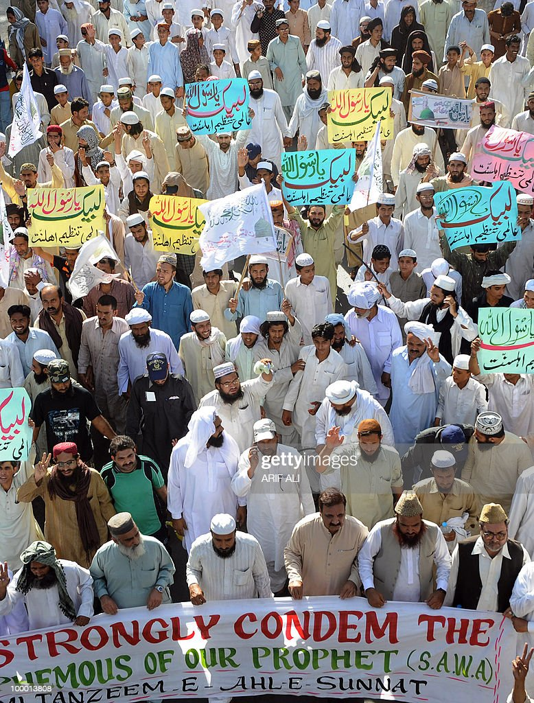 Pakistani Islamists shout slogans during a protest in Lahore on May 20, 2010, against the published caricatures of Prophet Mohammed on Facebook. Pakistan condemned caricatures of the Prophet Mohammed that appeared on Facebook, blocking the social networking site and YouTube in a growing backlash over Internet 'sacrilege'. Several thousand activists protested against the drawings and denounced the West in an expression of outrage that sparked comparisons with riots across the Muslim world in 2006 over drawings published in European newspapers.