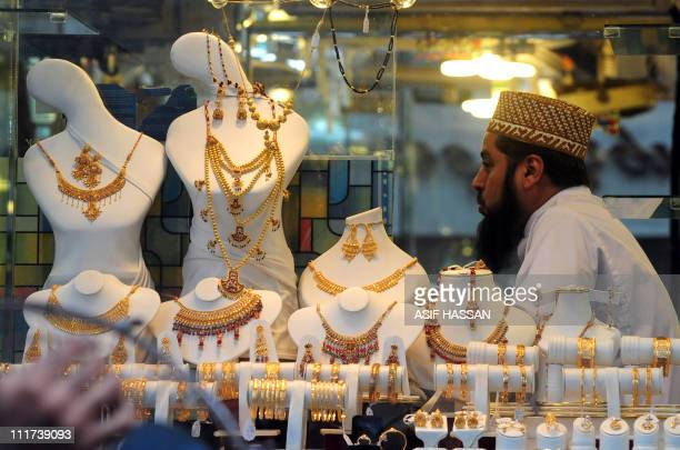 A Pakistani jeweler waits for customers at his shop in Karachi on April 6 2011 The gold prices have touched a historic high with 46650 Pakistani...