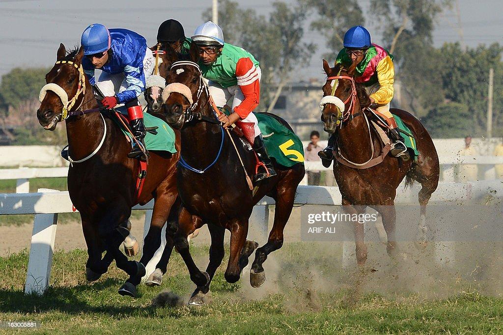 Pakistani jockey Amir Parviaz (L) rides Denzaro in the annual Derby Horse Race in Lahore on March 3, 2013. Parviaz on Denzaro finished first in the race at the Lahore Race Club (LRC). AFP PHOTO/Arif ALI