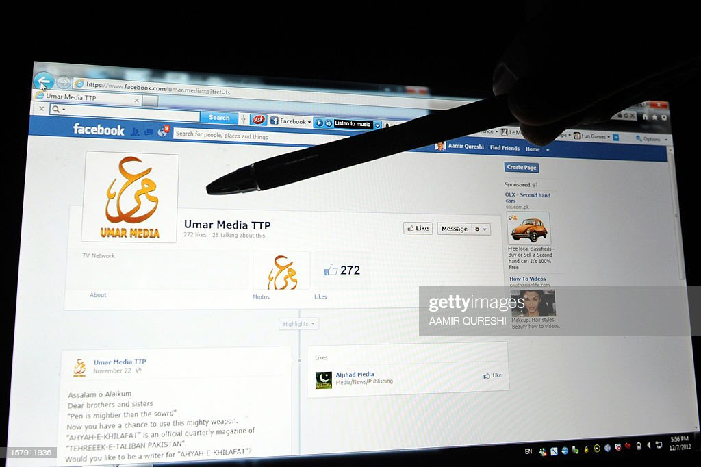 A Pakistani journalist gestures at a Facebook page used by Tehreek-e-Taliban Pakistan (TTP) displayed on a laptop computer screen in Islamabad on December 7, 2012. Pakistani Taliban has set up a page on Facebook to recruit enthusiasts to write for a quarterly magazine and to edit video, a spokesman confirmed Friday. The Umar Media TTP page, which has more than 270 likes, appears to have been created in September and has just a handful of messages written in English. AFP PHOTO/Aamir QURESHI