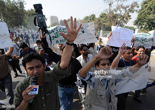 Pakistani journalists and employees of private Geo news channel shout slogans as they march during a protest in Karachi on March 14 2009 con March 14...