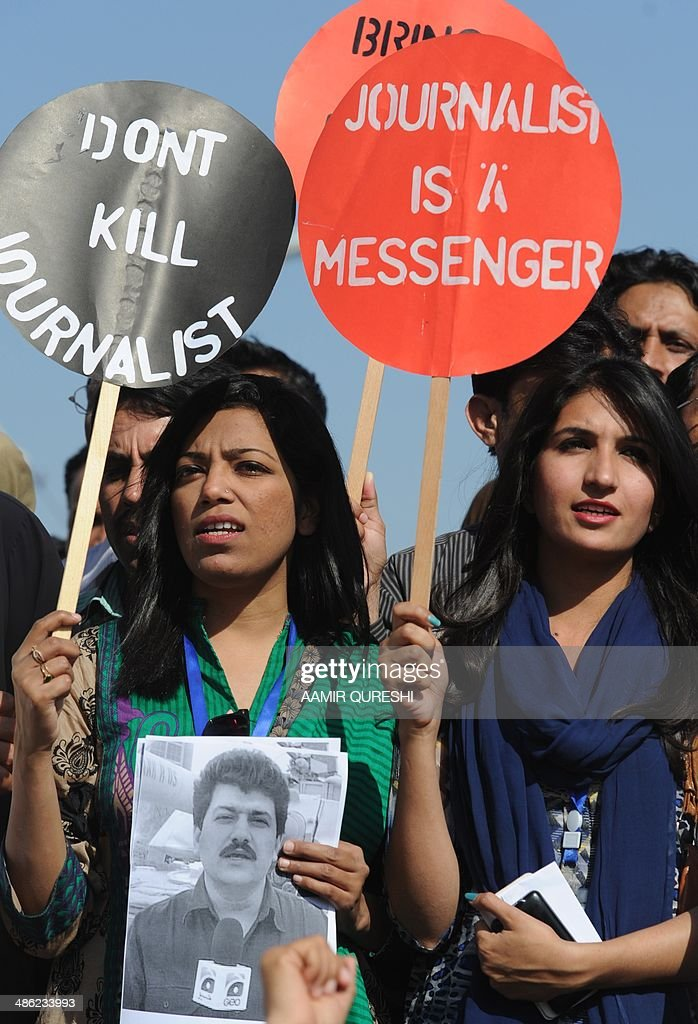 Pakistani journalists hold placards and photographs bearing the image of Geo television journalist Hamid Mir during a protest against the attack on Mir by gunmen in Islamabad on April 23, 2014. Pakistan's defence ministry has asked for the country's top-rating television channel to be shut down after it broadcast allegations blaming an intelligence agency for shooting a leading journalist, officials said. The move comes after Geo aired claims that Pakistan's powerful Inter-Services Intelligence (ISI) agency was behind the shooting of prominent anchor Hamid Mir in Karachi on April 19, 2014. AFP PHOTO/Aamir QURESHI