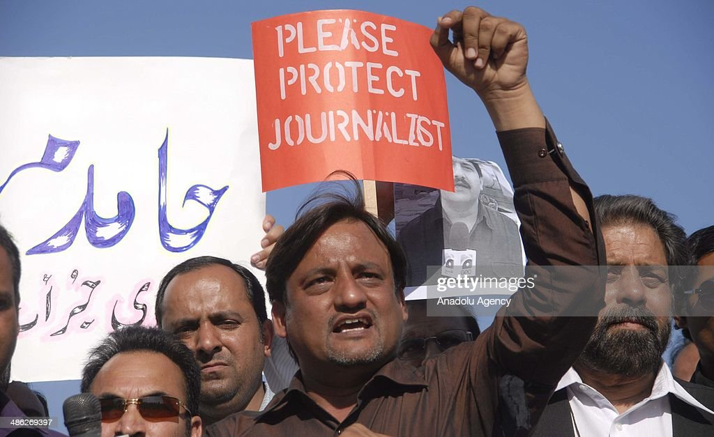 Pakistani journalists hold placards and photographs bearing the image of Geo television journalist Hamid Mir during a protest against the attack on Mir by gunmen in Islamabad on April 23, 2014. Pakistan's defence ministry has asked for the country's top-rating television channel to be shut down after it broadcast allegations blaming an intelligence agency for shooting a leading journalist, officials said.