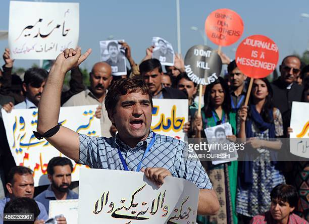 Pakistani journalists shout slogans during a protest against the attack on Geo television journalist Hamid Mir by gunmen in Islamabad on April 23...