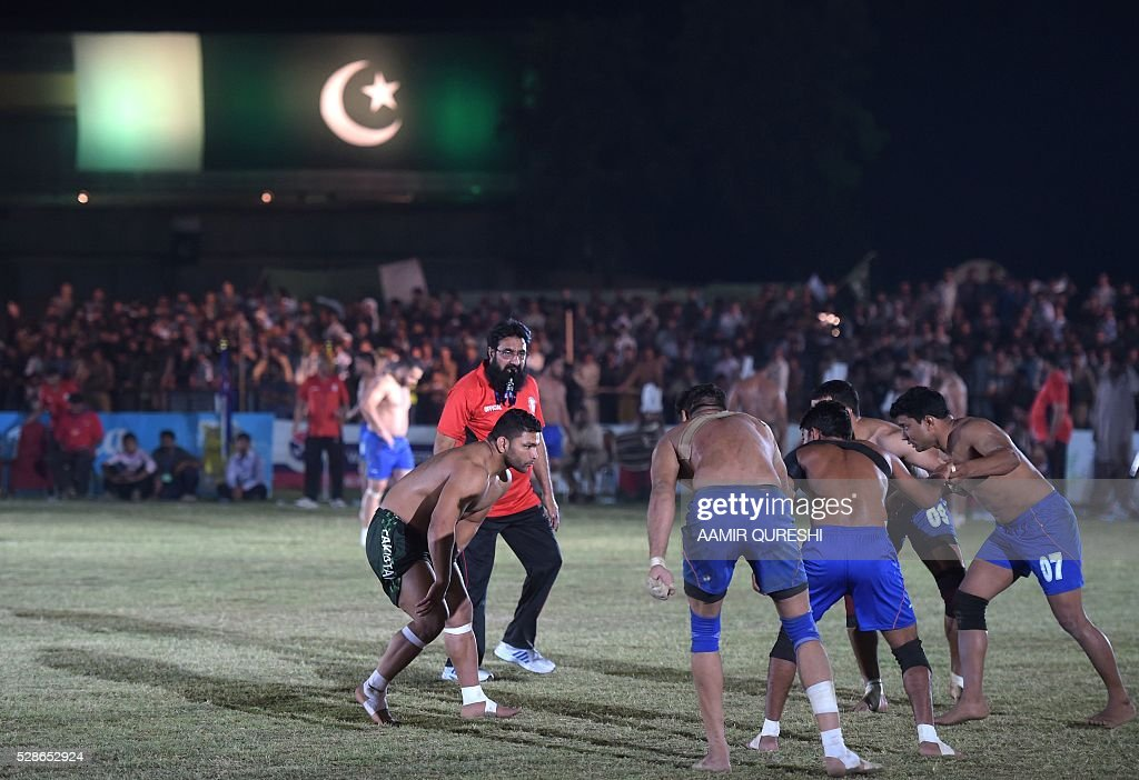 A Pakistani kabaddi player (L) attempts to tag an Indian opponent during their final match of the 3rd Asian Kabaddi Circle Style Championship 2016 in Wah some 45 kilometers from Islamabad on May 6, 2016. QURESHI
