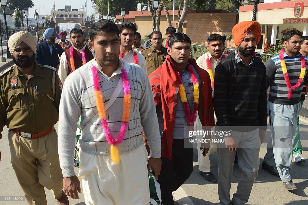 Pakistani kabaddi team players arrive at the India-Pakistan Wagah Border on December 3, 2012. The 16-member Pakistani team along with team captain Musharraf Javed, arrived in India to play in the 3rd Kabaddi World Cup 2012 tournament in Hoshiarpur, which runs from December 1-15.