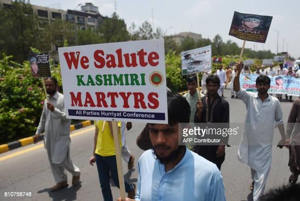 Pakistani Kashmiri men march to mark the death anniversary of popular rebel leader Burhan Wani in Islamabad on July 8 2017 NAEEM