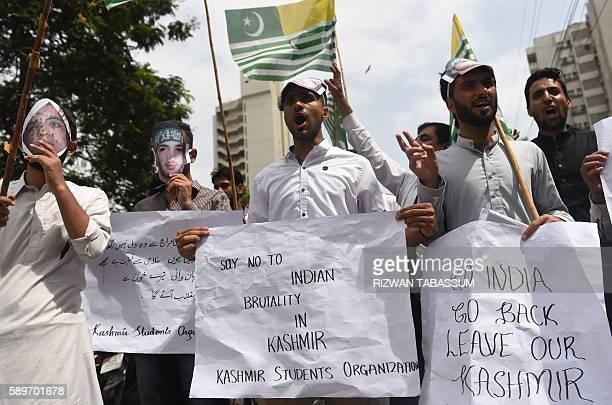 Pakistani Kashmiri students wear masks bearing the image of slain Indian Kashmiri rebel leader Burhan Wani as they shout antiIndian slogans during at...