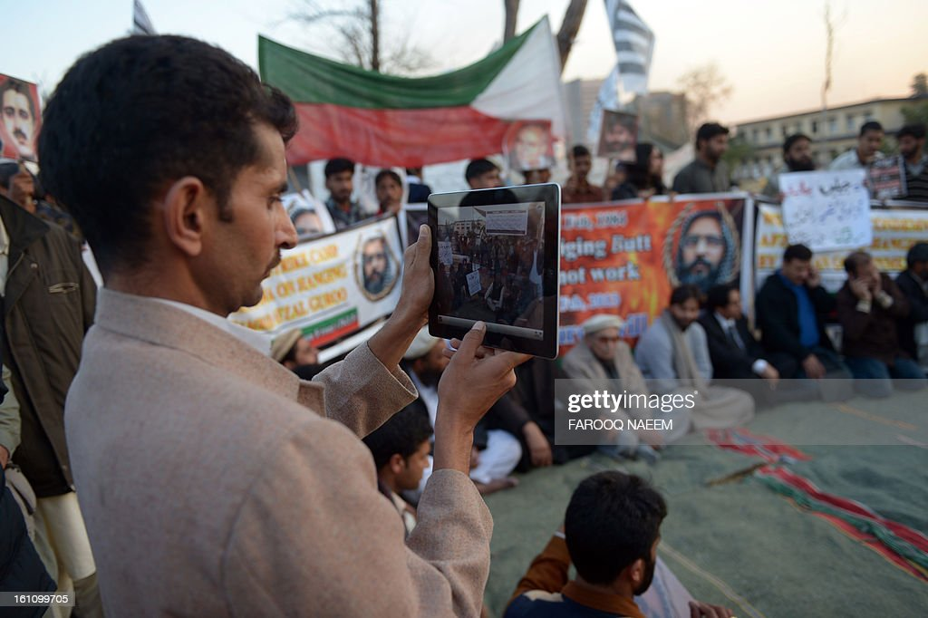 A Pakistani Kashmiri takes photographs with his computer tablet during a protest against the execution of Kashmiri separatist Mohammed Afzal Guru in the Indian capital New Delhi, in Islamabad on February 9, 2013. A Kashmiri separatist was executed Saturday over his role in a deadly attack on parliament in New Delhi in 2001, an episode that brought nuclear-armed India and Pakistan to the brink of war. Hundreds of protesters on Saturday rallied in Muzaffarabad, the capital of Pakistan-administered Kashmir, to condemn the execution of a Kashmiri separatist in India. AFP PHOTO/Farooq NAEEM