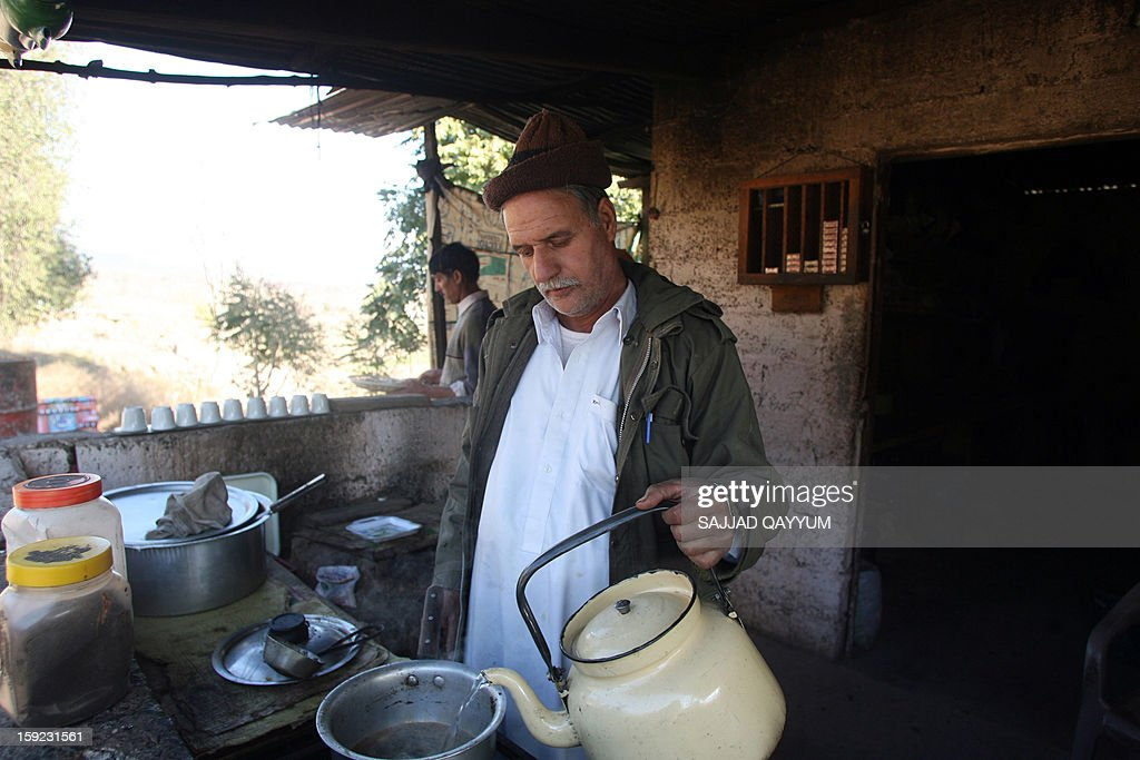 A Pakistani Kashmiri tea vendor makes a brew for customers at his stall on the way to the town of Titrinot, some 30 kilometers north of Battal sector close of Pakistan-India border, on January 10, 2013. Pakistan on January 10 accused Indian troops of opening fire and killing a Pakistani soldier, the third deadly cross-border incident in days that threatens to escalate tensions in Kashmir. The Pakistan military said the incident happened in the Battal area of the disputed Himalayan region, where a ceasefire has held on heavily militarised Line of Control since 2003, despite violations on both sides. AFP PHOTO/Sajjad QAYYUM