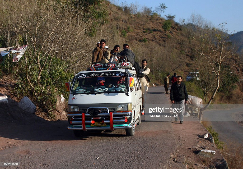 Pakistani Kashmiris ride a van heading towards the town of Titrinot, some 30 kilometers north of Battal sector close of Pakistan-India border, on January 10, 2013. Pakistan on January 10 accused Indian troops of opening fire and killing a Pakistani soldier, the third deadly cross-border incident in days that threatens to escalate tensions in Kashmir. The Pakistan military said the incident happened in the Battal area of the disputed Himalayan region, where a ceasefire has held on heavily militarised Line of Control since 2003, despite violations on both sides. AFP PHOTO/Sajjad QAYYUM