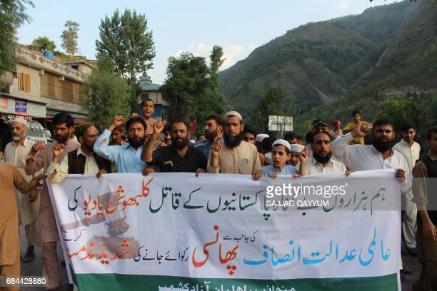 Pakistani Kasmiris hold a banner as they shout slogans during a protest against the UN in Muzaffarabad on May 18 2017 The UN's top court on May 18...