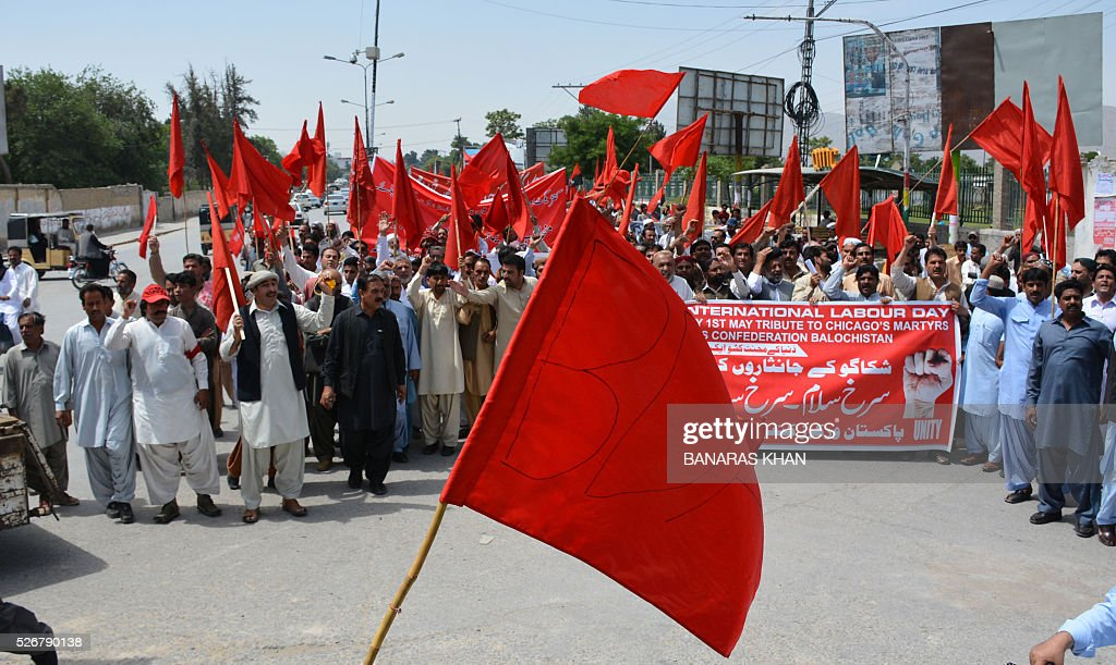 Pakistani labourers shout slogans and wave placards as they march behind banners at a rally in Quetta on May 1, 2016, on International Labour Day or May Day. / AFP / BANARAS