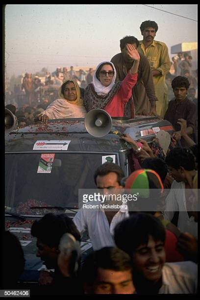 Pakistani leader Benazir Bhutto a PPP candidate waving campaigning from sun roof of car