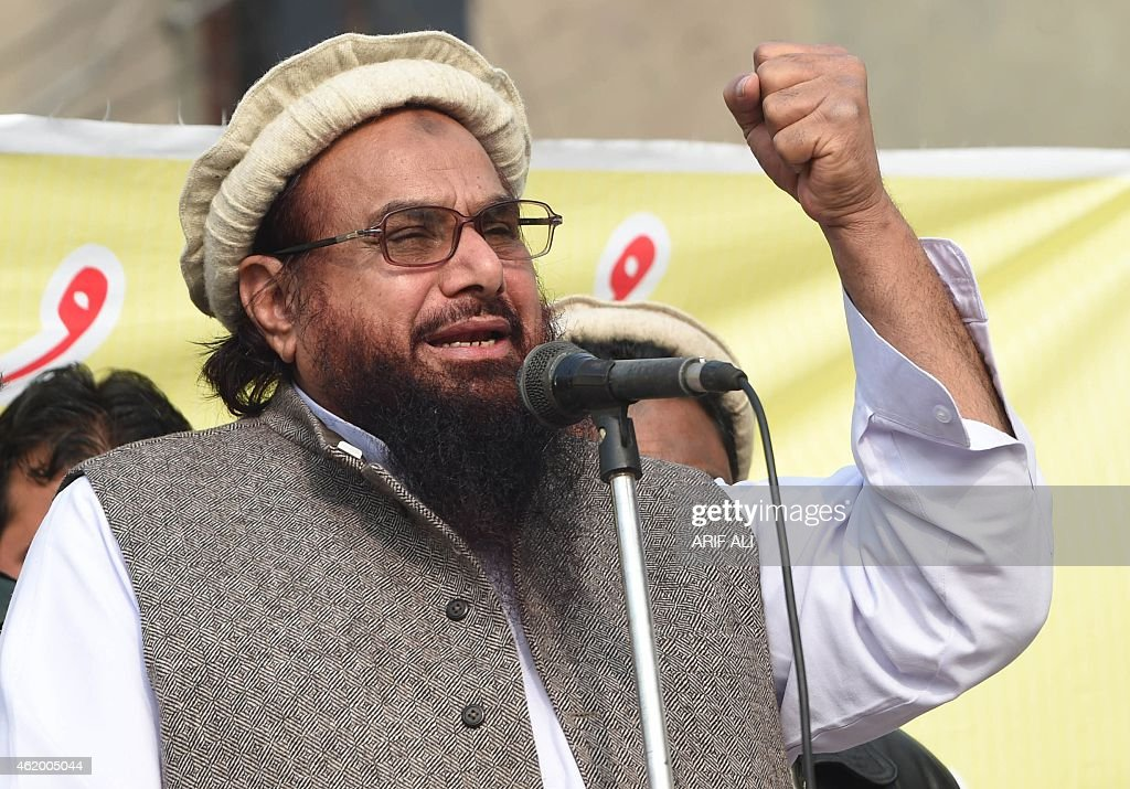 Pakistani leader of the Jamat ud-Dawa organisation Hafiz Saeed addresses a rally against the printing of satirical sketches of the Prophet Mohammed by French magazine Charlie Hebdo in Lahore on January 23, 2015. Thousands of people marched in Pakistan January 23 against French satirical magazine Charlie Hebdo as anger remains high in the Muslim majority country over the publication of cartoons of the Prophet Mohammed. AFP PHOTO / Arif ALI