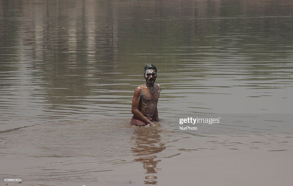 A pakistani man bathing in ravi river for cool themselves due to hot weather in Lahore, Pakistan, on May 06, 2016.