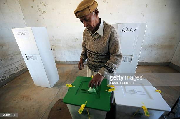 A Pakistani man casts his ballot at a polling station in Chakri some 40 km from Islamabad on February 18 2008 as the nation goes to the polls...