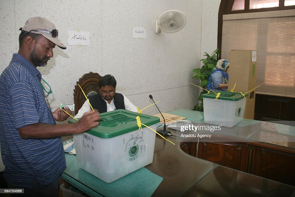 Pakistani man casts his ballot at a polling station within mayoral election in Karachi Pakistan on August 24 2016