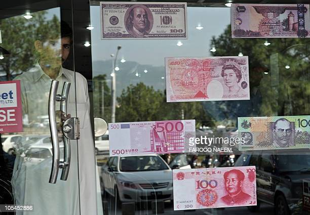 A Pakistani man exits a currency exchange shop in Islamabad on October 14 2010 The US dollar fell against most Asian currencies while the region's...