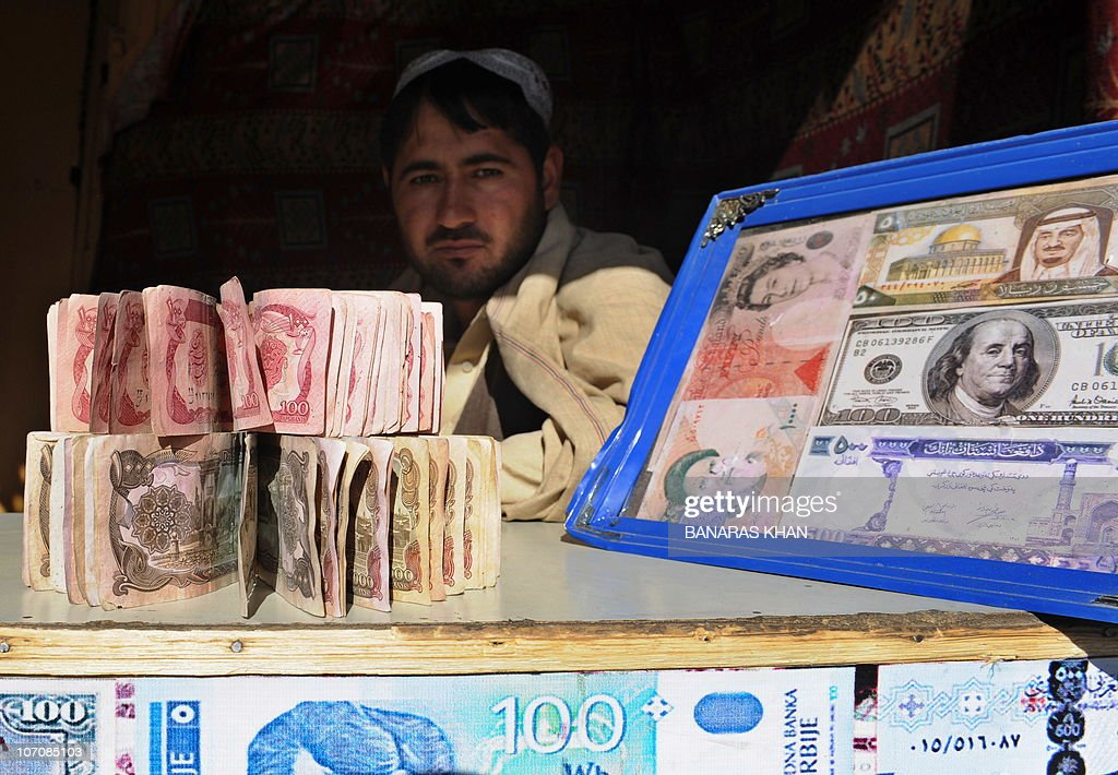 A Pakistani man holds banknotes as he waits for the customers at his currency exchange shop in Quetta on November 22 2010 The European single...
