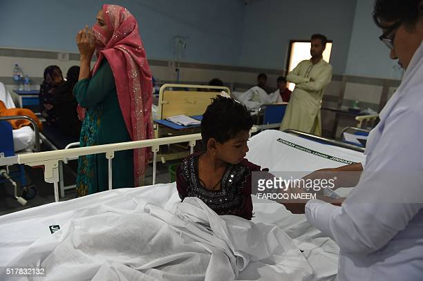 A Pakistani man injured in a suicide blast rests in a hospital in Lahore on March 28 2016 A suicide bomber who attacked a park thronging with...