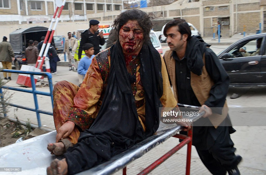 A Pakistani man pushes a stretcher carring an injured blast victim to a hospital after a bomb explosion in Quetta on January 10, 2013. A bomb attack killed 11 people and wounded dozens more in a crowded part of Pakistan's southwestern city of Quetta, police said. AFP PHOTO/Banaras KHAN