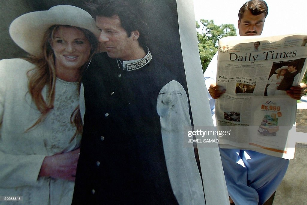 A Pakistani man reads a national daily featuring on its front page a picture of former Pakistani cricket hero turned politician <a gi-track='captionPersonalityLinkClicked' href=/galleries/search?phrase=Imran+Khan+-+Politician&family=editorial&specificpeople=13488792 ng-click='$event.stopPropagation()'>Imran Khan</a> and his British wife Jemima, at a newspaper stall in Islamabad, 23 June 2004. Khan and Jemima have divorced, ending their nine-year-marriage, it was announced yesterday. AFP PHOTO/Jewel SAMAD