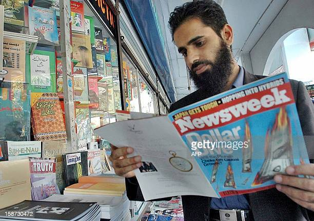 A Pakistani man reads the latest edition of the US magazine Newsweek at a bookstall in Islamabad 27 November 2004 Pakistan has ordered the...