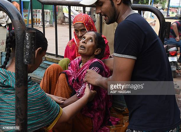 A Pakistani man shifts a heatwave victim to a hospital in Karachi on June 22 2015 Nearly 200 people have died in a heatwave in southern Pakistan...